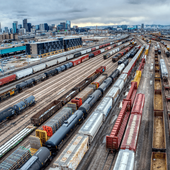 An overhead shot of a rail yard filled with freight trains.