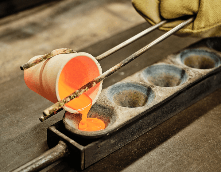 Molten metal being poured into a mold for analysis.