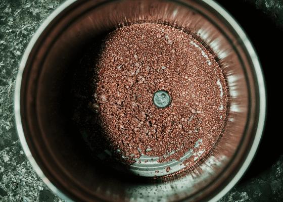 An overhead shot a barrel filled with copper scrap.