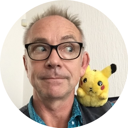 Headshot of Les Bubb with a Pikachu doll