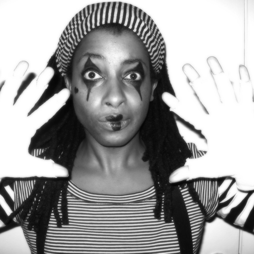 Black woman dressed as a mime