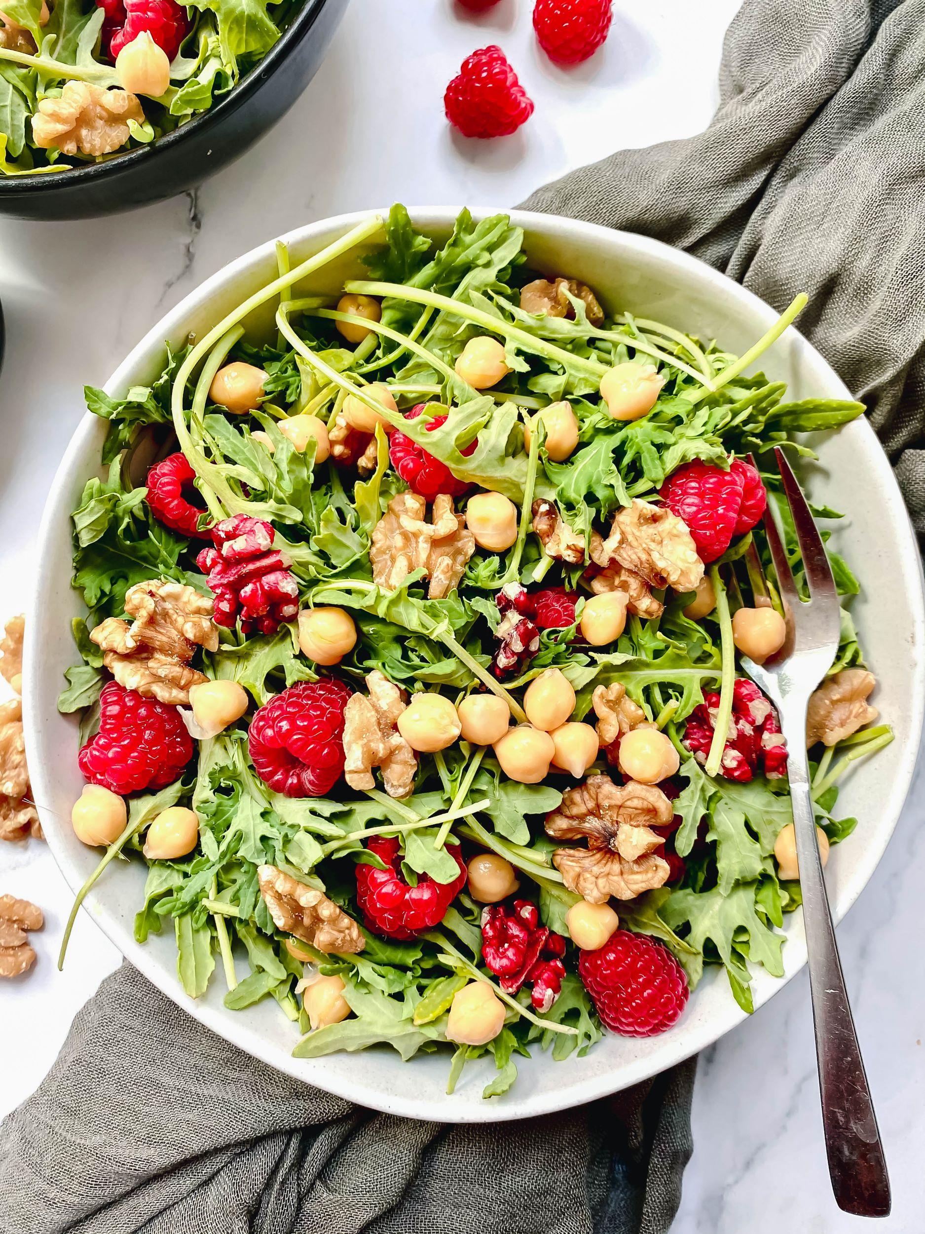 Raspberry Walnut Kale Salad with Creamy Garlic Turmeric Dressing