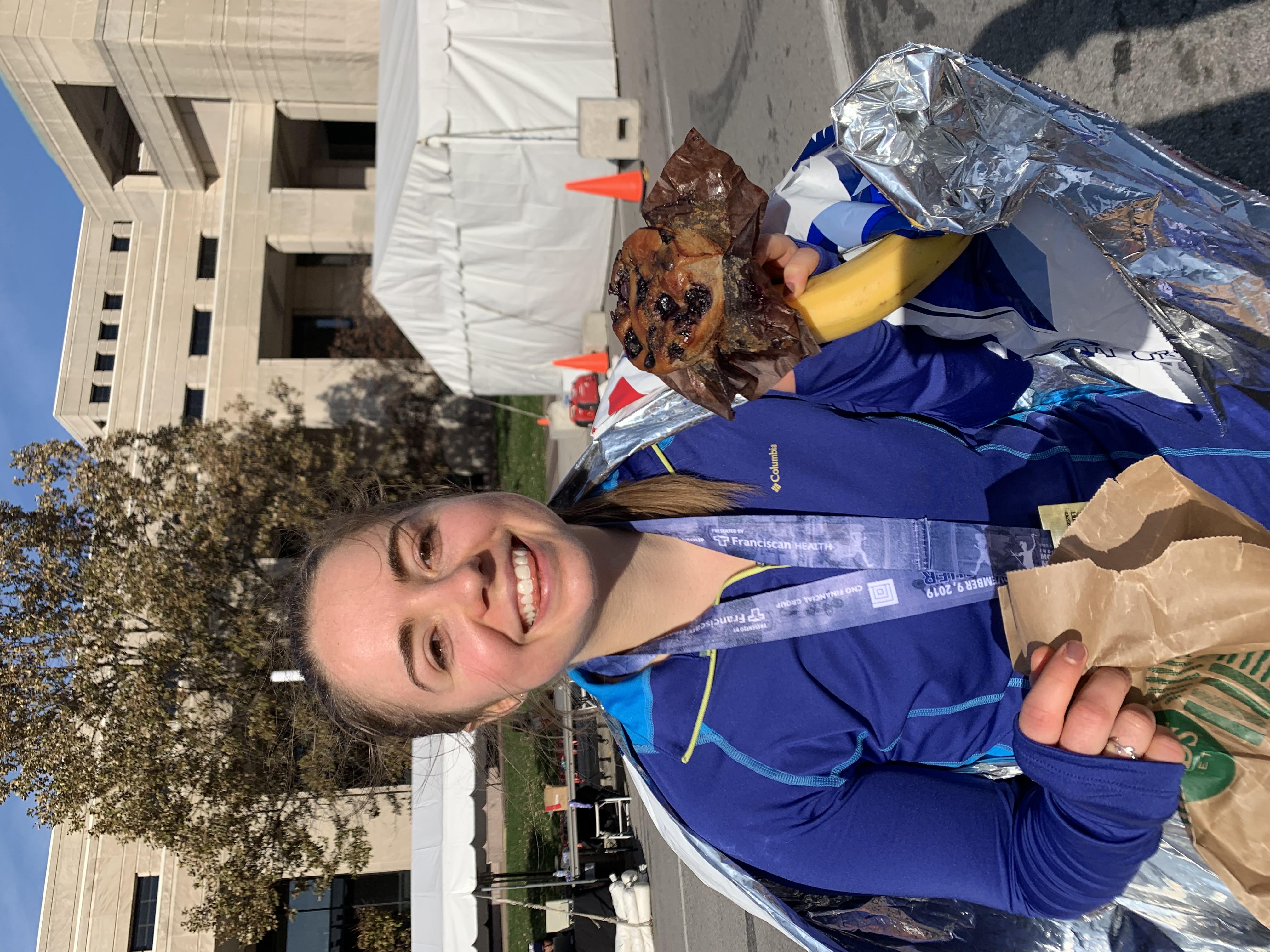 Elizabeth holding a muffin post-marathon