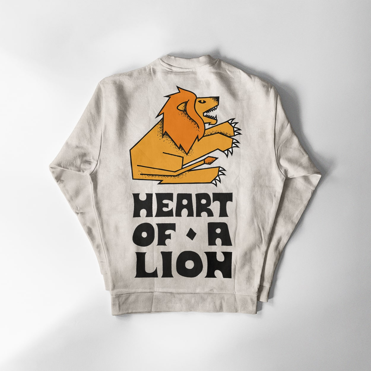 A sweatshirt with the words 'Heart of a Lion' written on the back and an illustration of a lion