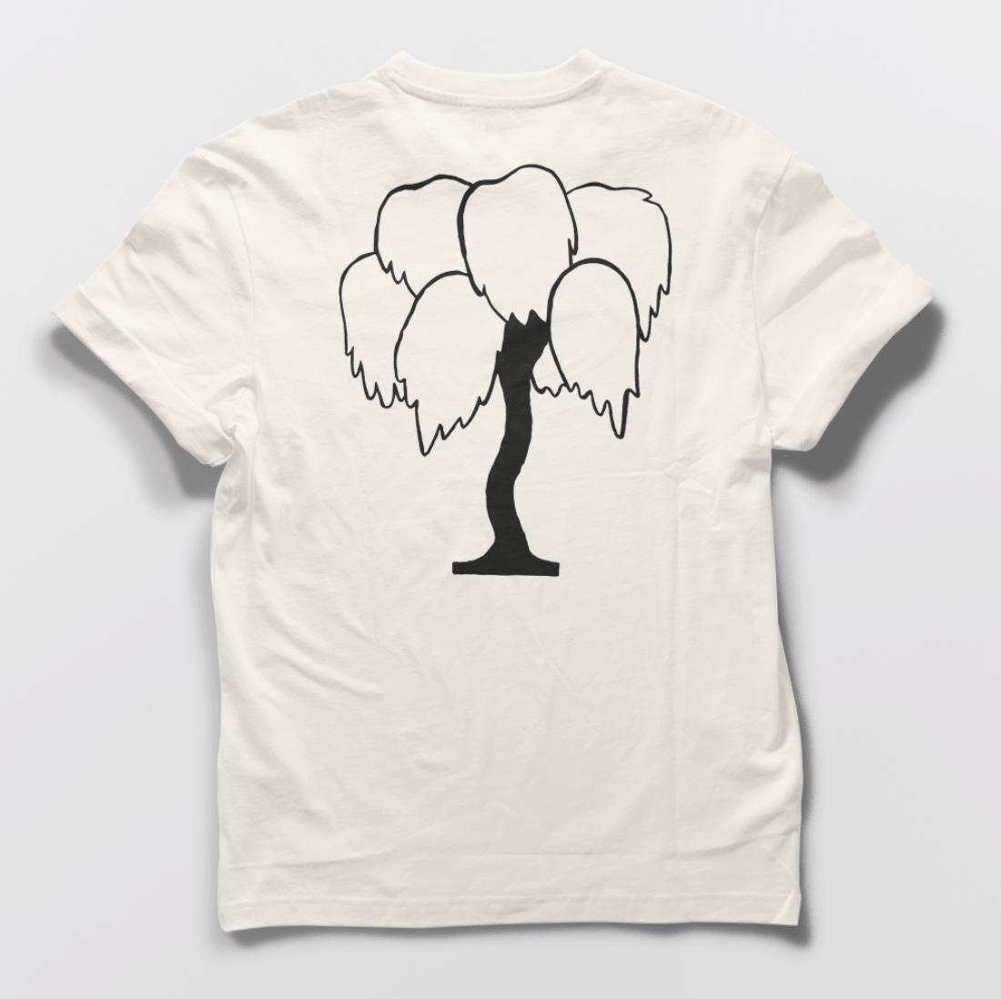 A white T-shirt with a black painting of a tree on the back