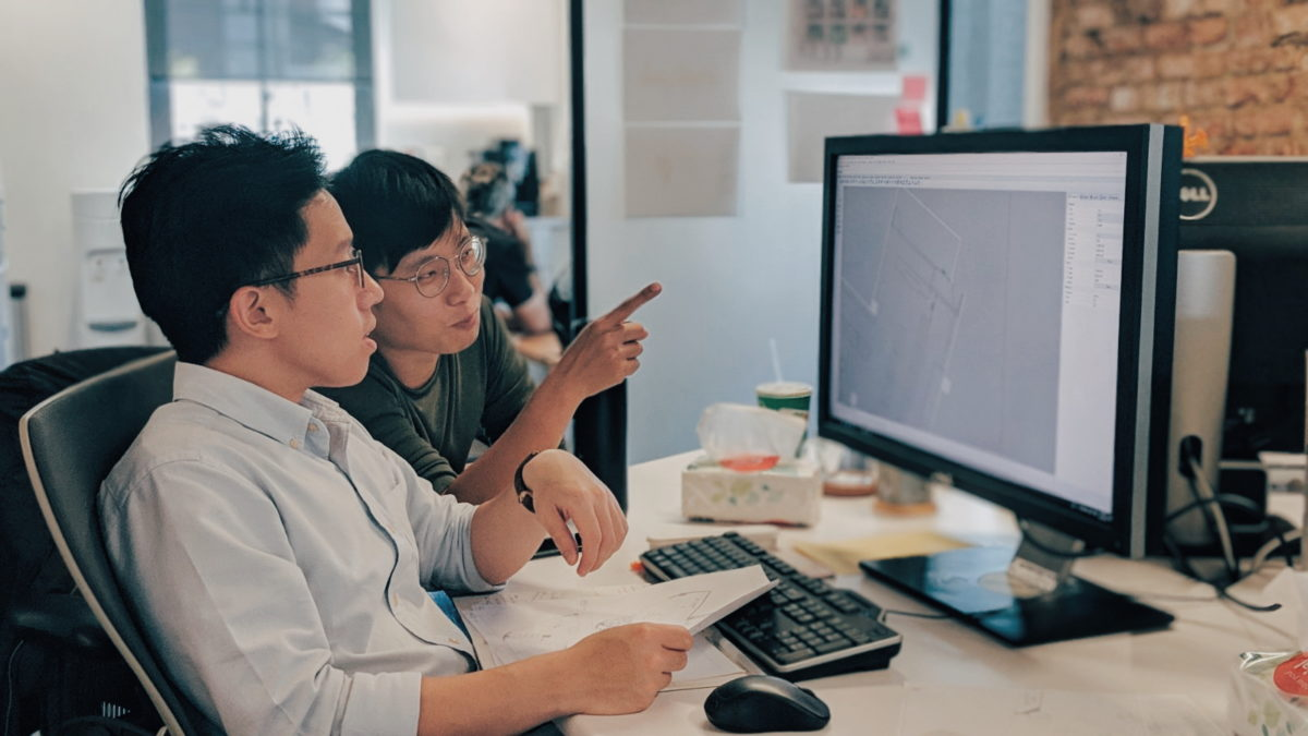 Chemistry, Singapore Design Agency in Singapore, Teo Kaisheng and Daniel Wee, Industrial Designer and UX Designer working on blueprints
