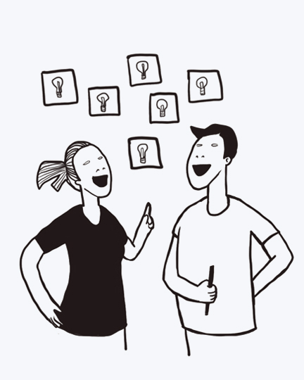 A man and a woman discussing ideas in an ideation sprint.