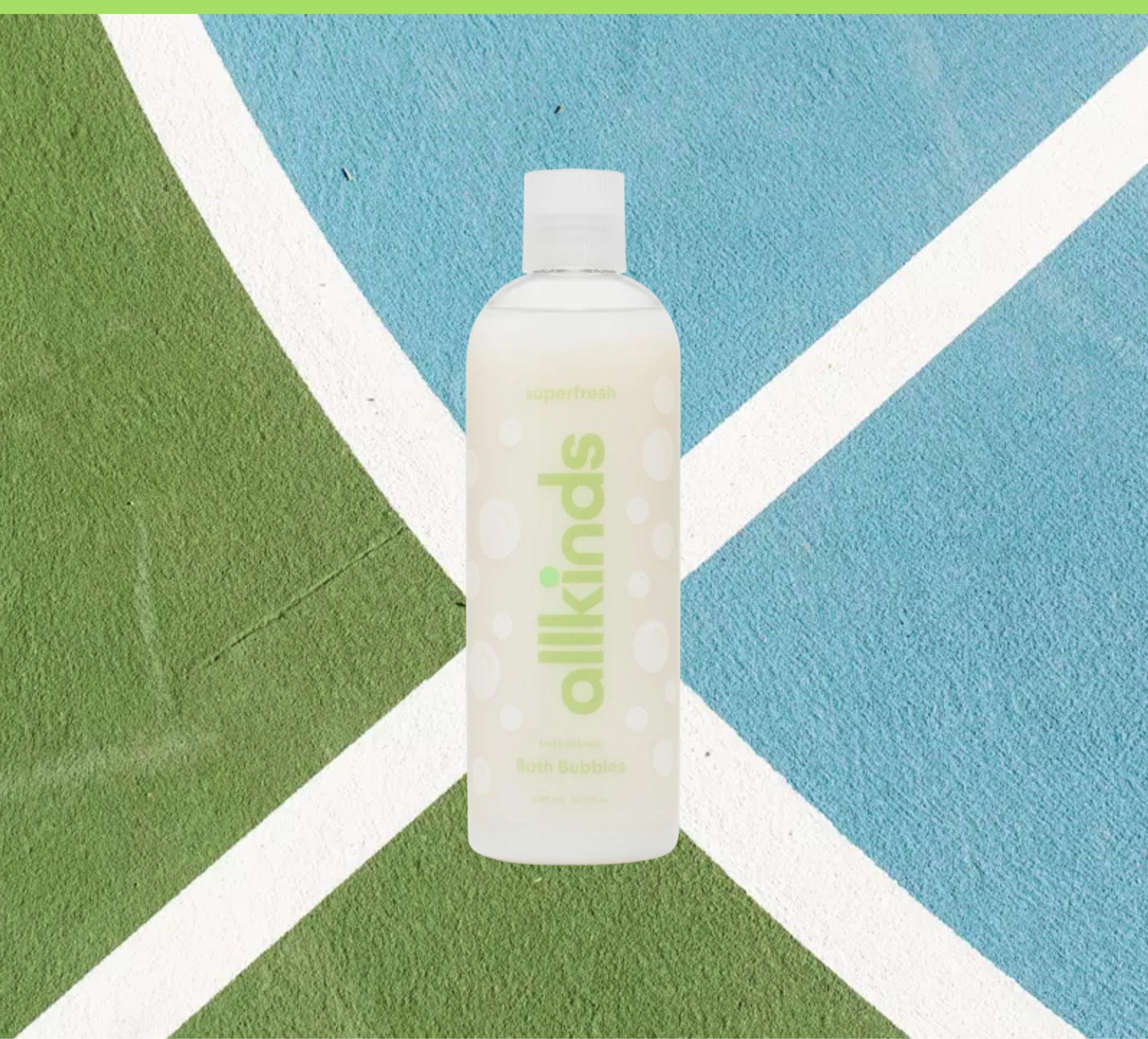 Allkinds Superfresh Bath Bubbles on a tennis court background