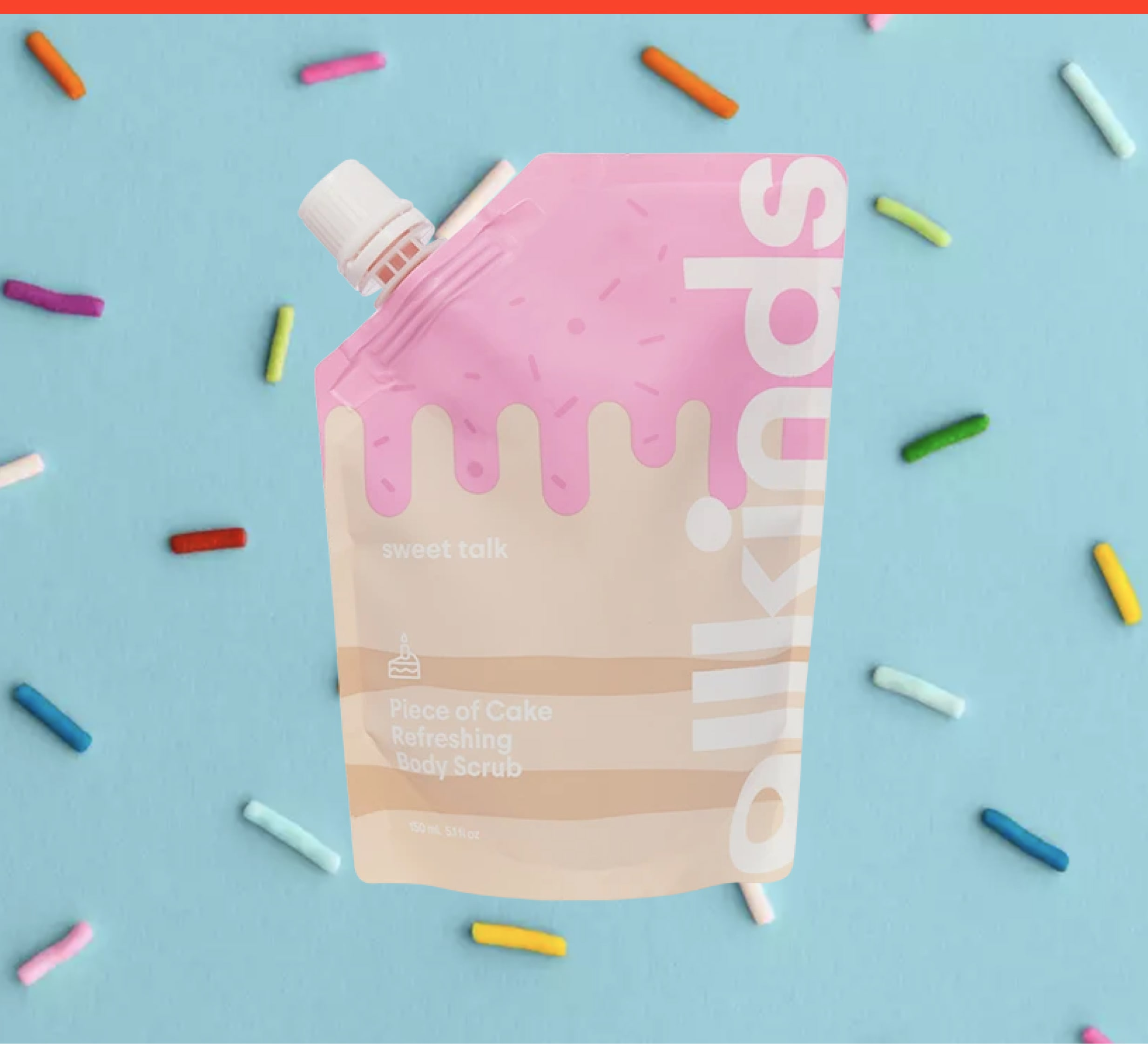 Sweet Talk Piece of Cake Refreshing Body Scrub on a blue sprinkles background
