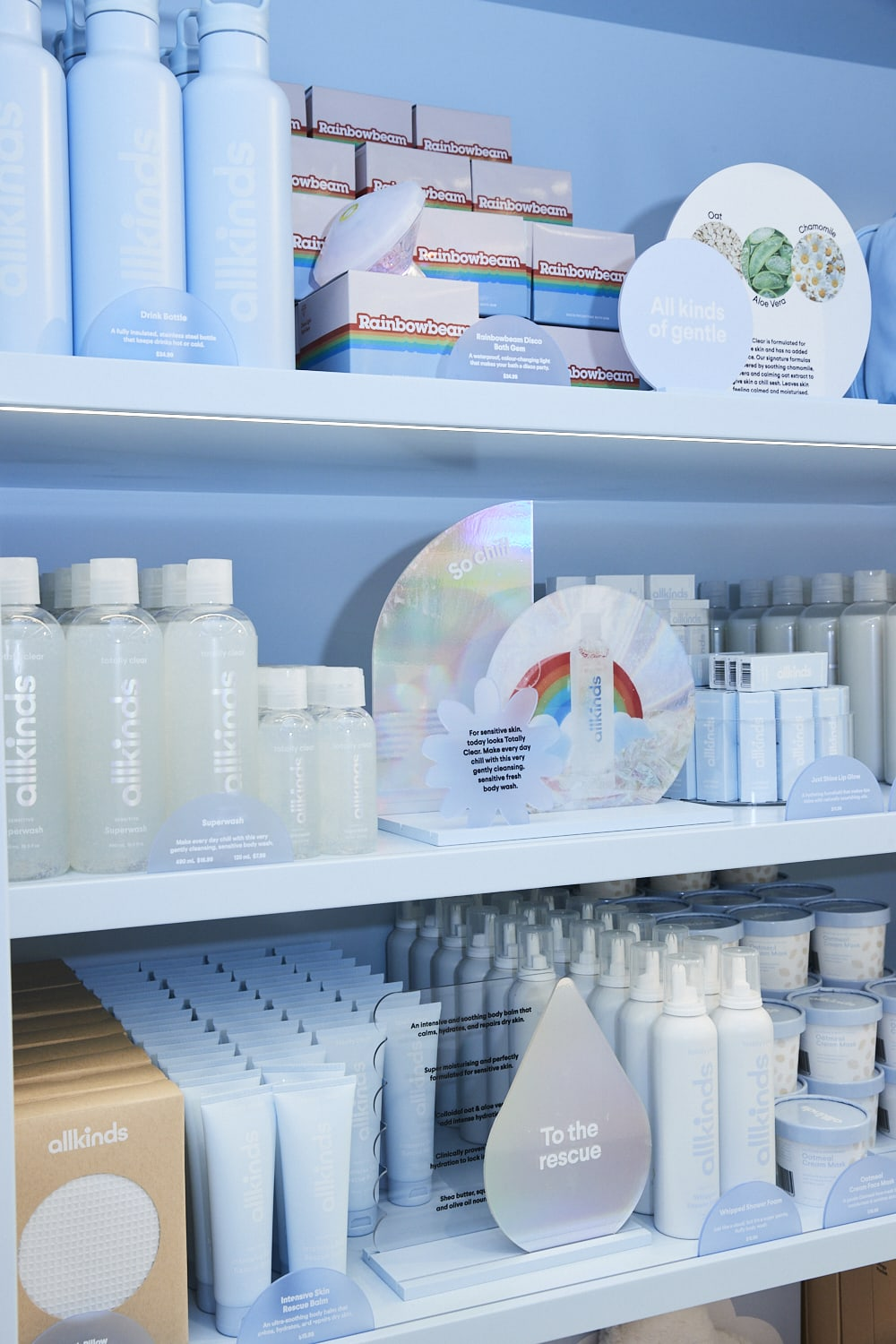 """Closeup of packaging and signage for Allkinds bath & body world """"Totally Clear"""""""