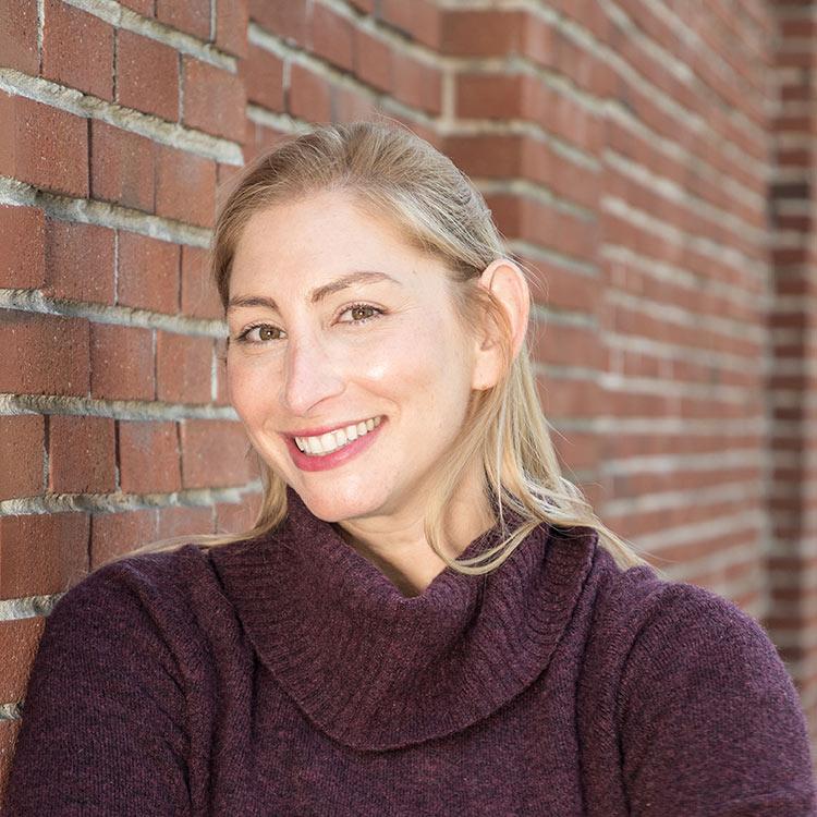 A headshot of Signos Chief Marketing Officer Hannah Russin.