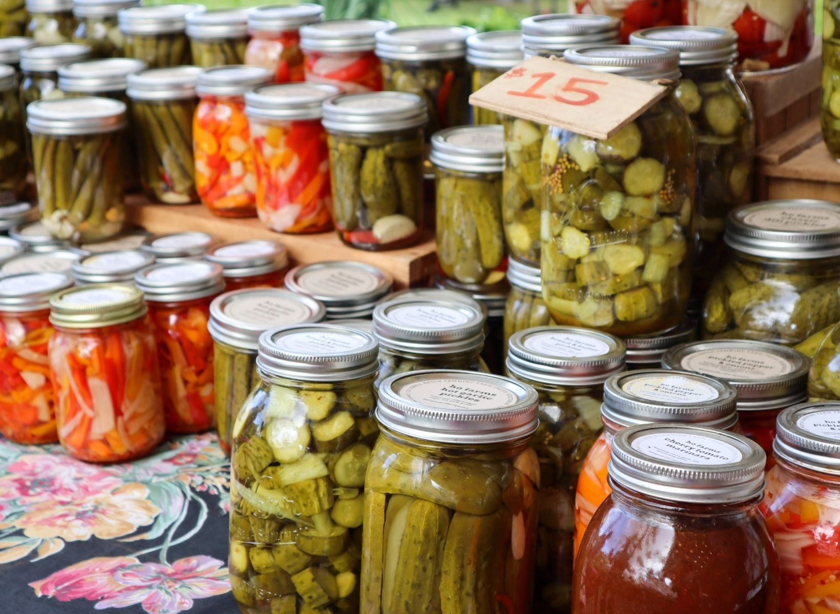 Numerous mason jars with probiotic-rich fermented foods, including pickles and vegetables.