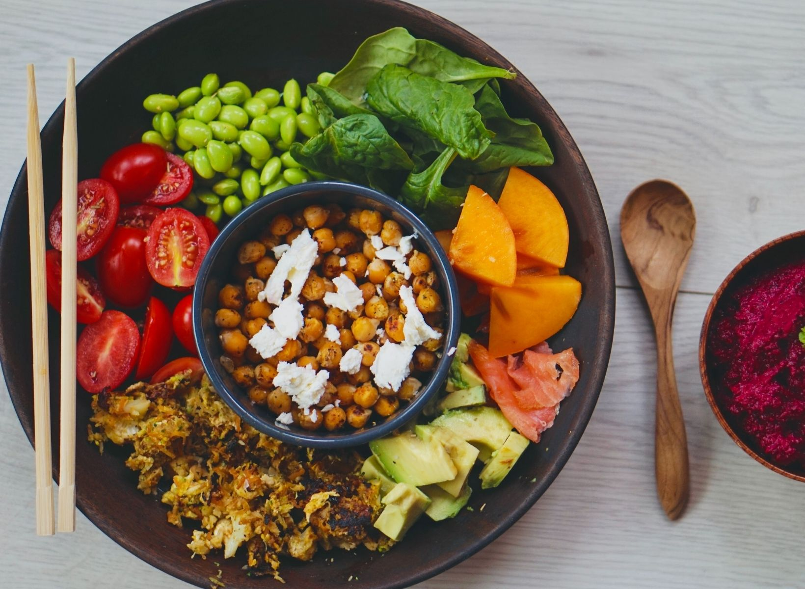 Overhead shot of a buddha bowl filled with vegetables and chickpeas