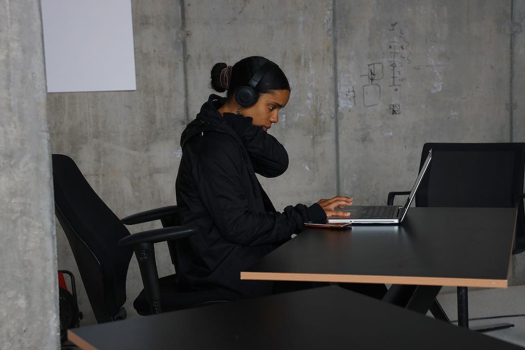 A designer works at their desk.