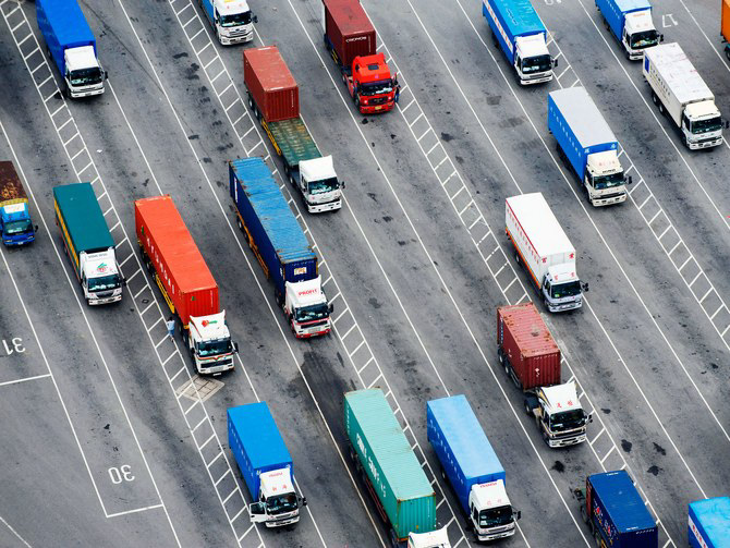 An aerial shot of trucks on a freeway.