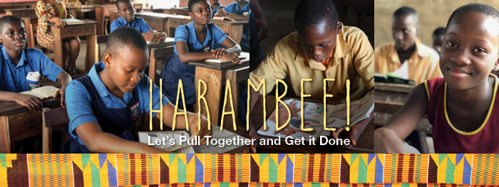 """Children in a classroom, with the word """"Harambee!"""" on top."""