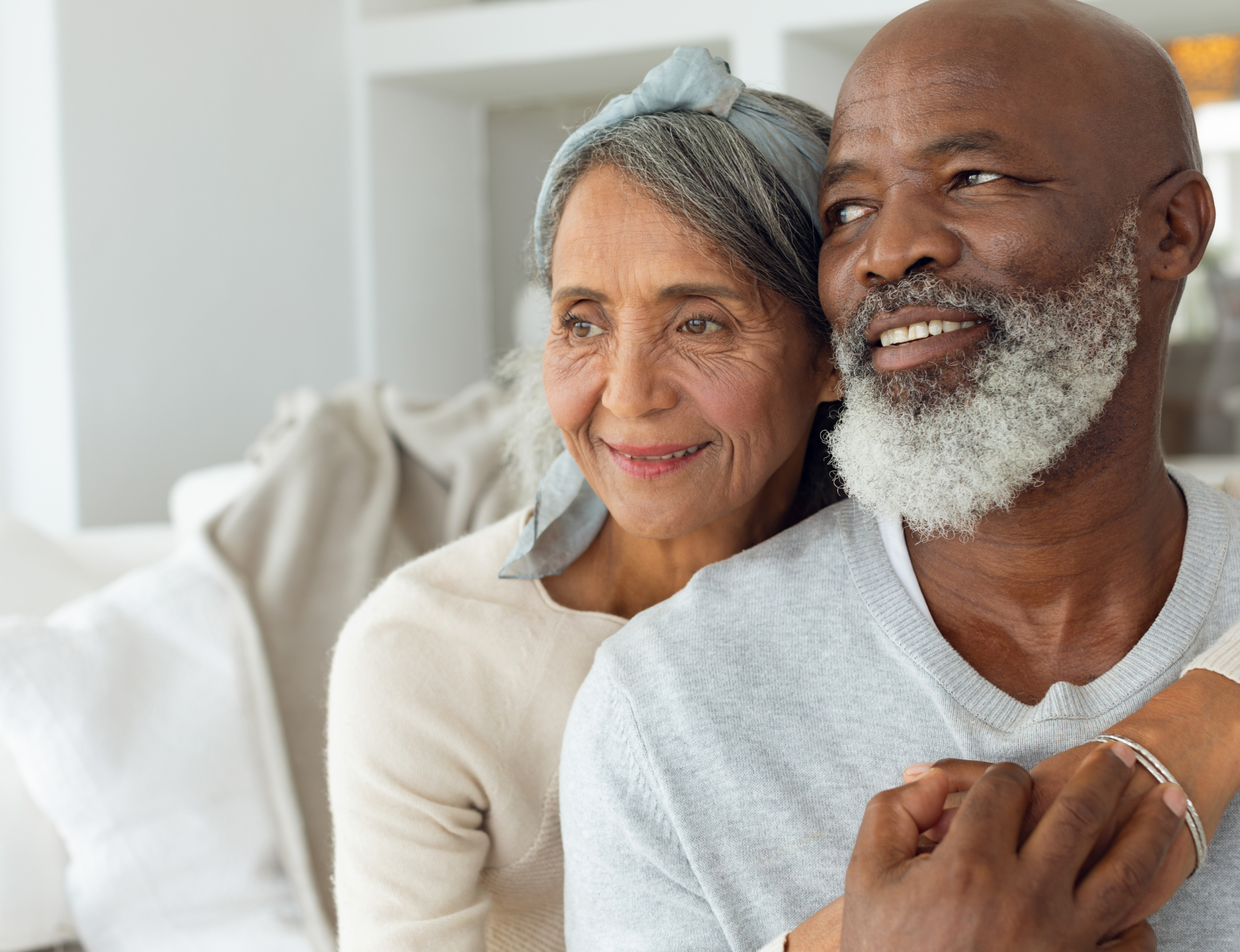 Interracial couple on couch - facing left