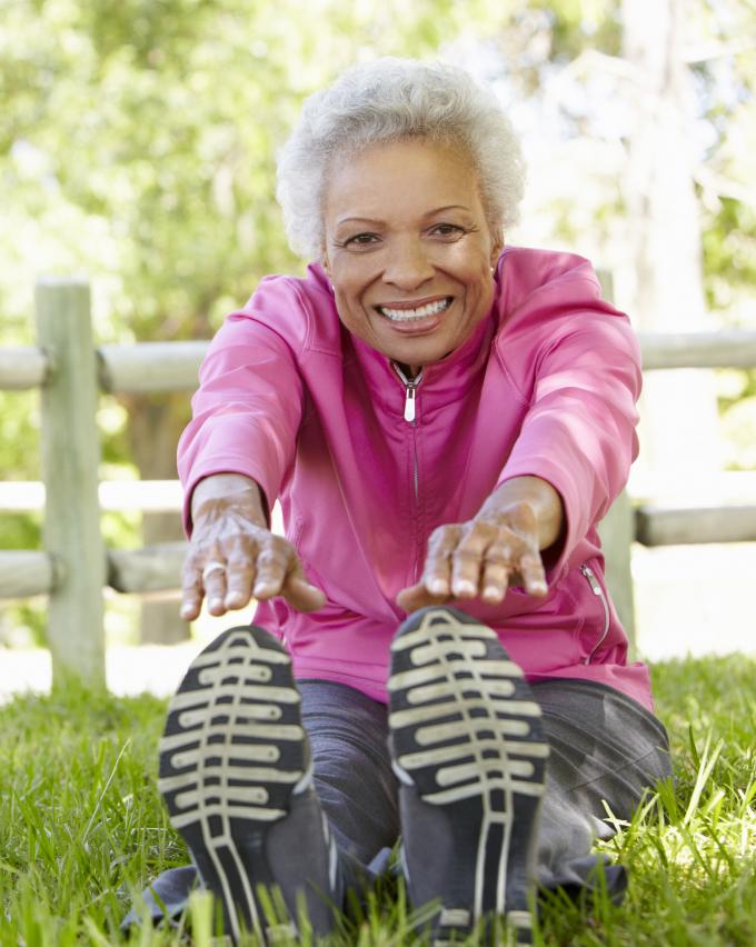 Older black woman stretching