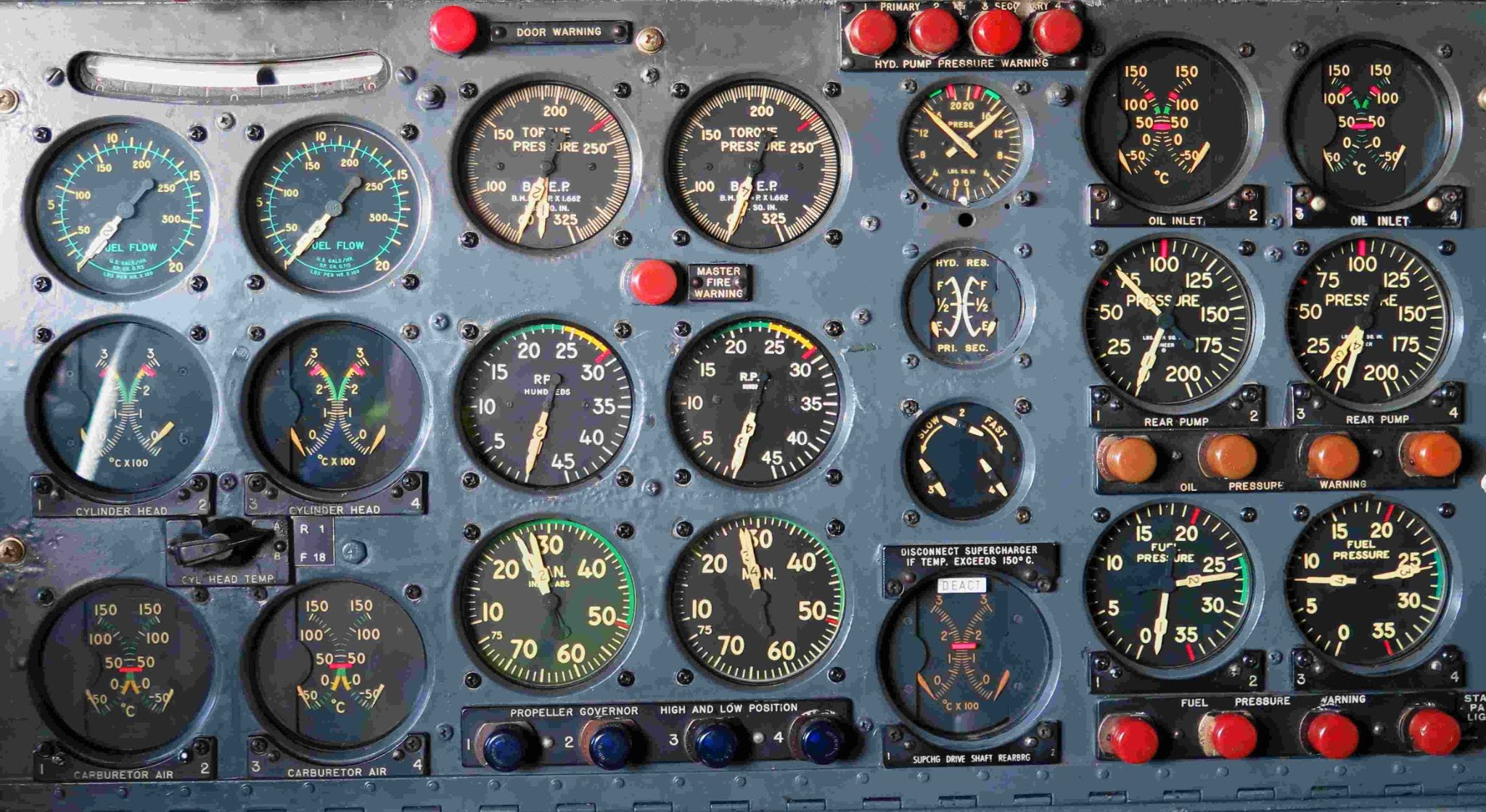 an airplane dashboard with many dials and buttons