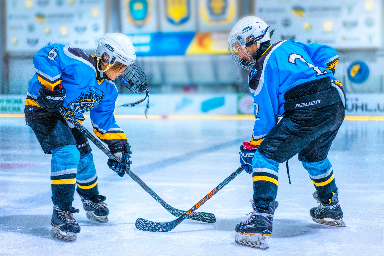 two kids playing hockey