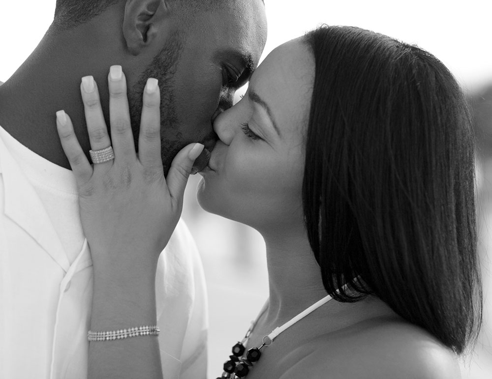 Couple embracing in a sensual kiss
