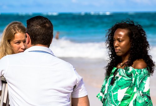 Marissa Nelson speaking with a couple on the beach