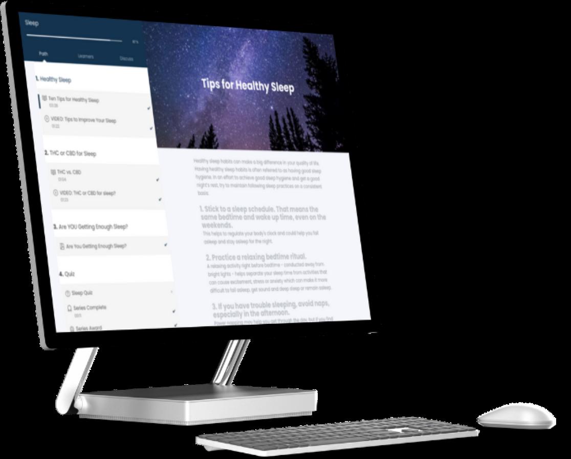 A super sleek computer desktop featuring JADEO's website on screen
