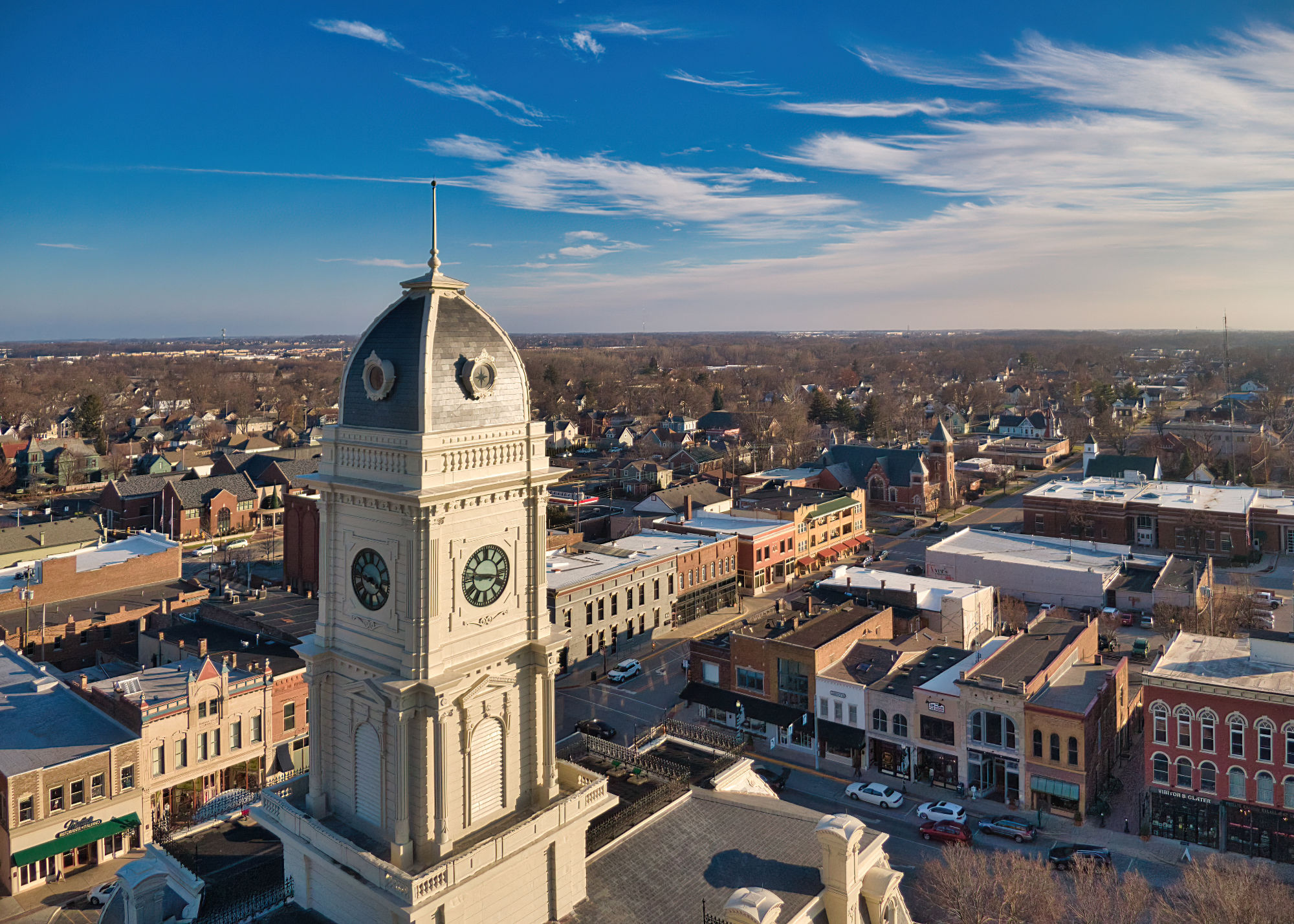 The Clock Tower in Noblesville, Indiana from the sky during a sunny winter Golden Hour