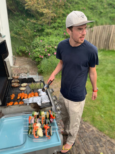 A team member of Venture IQ at a barbecue