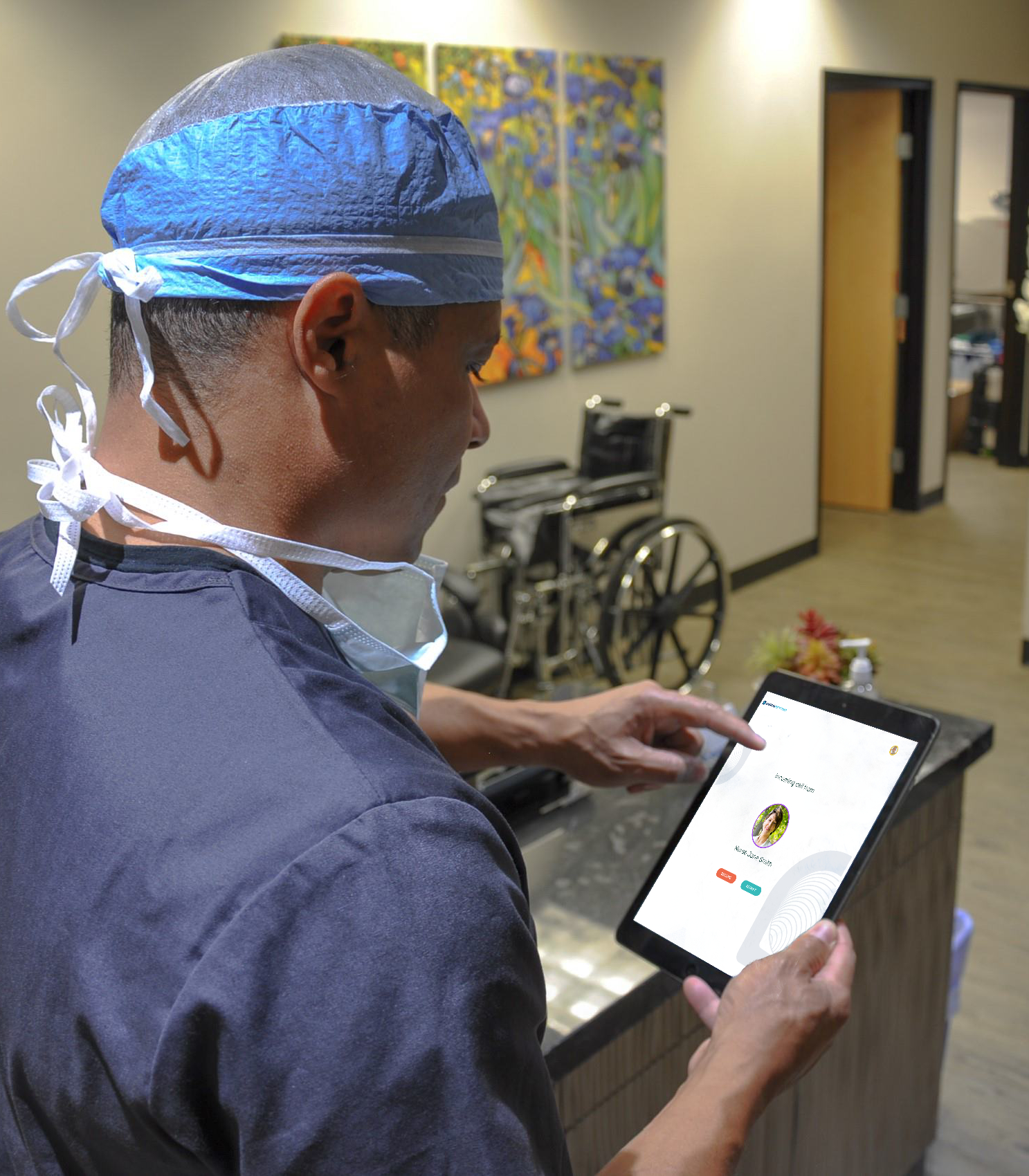 clinician using software on their tablet