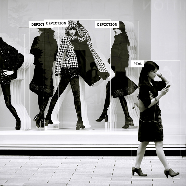 Woman walking by realistic mannequins