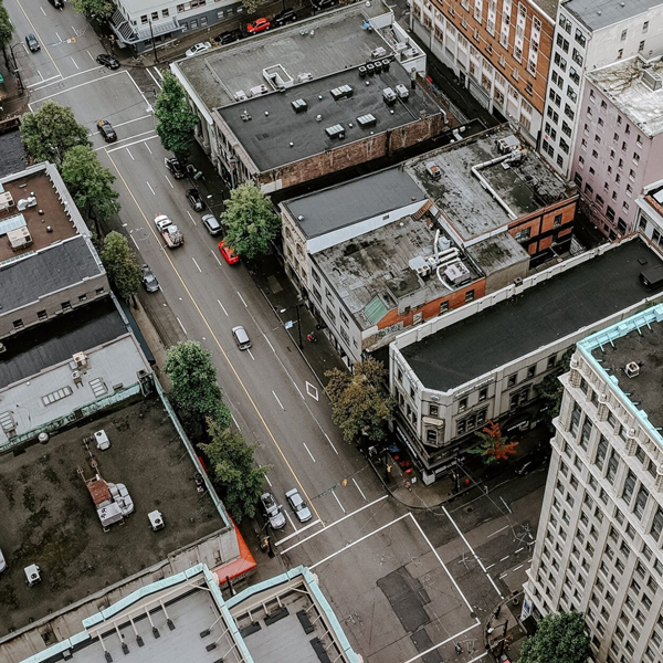 Bird's eye view of city street and apartment buildings.