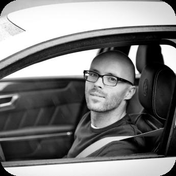 Influencer Komotar Minuta siting in a car, image