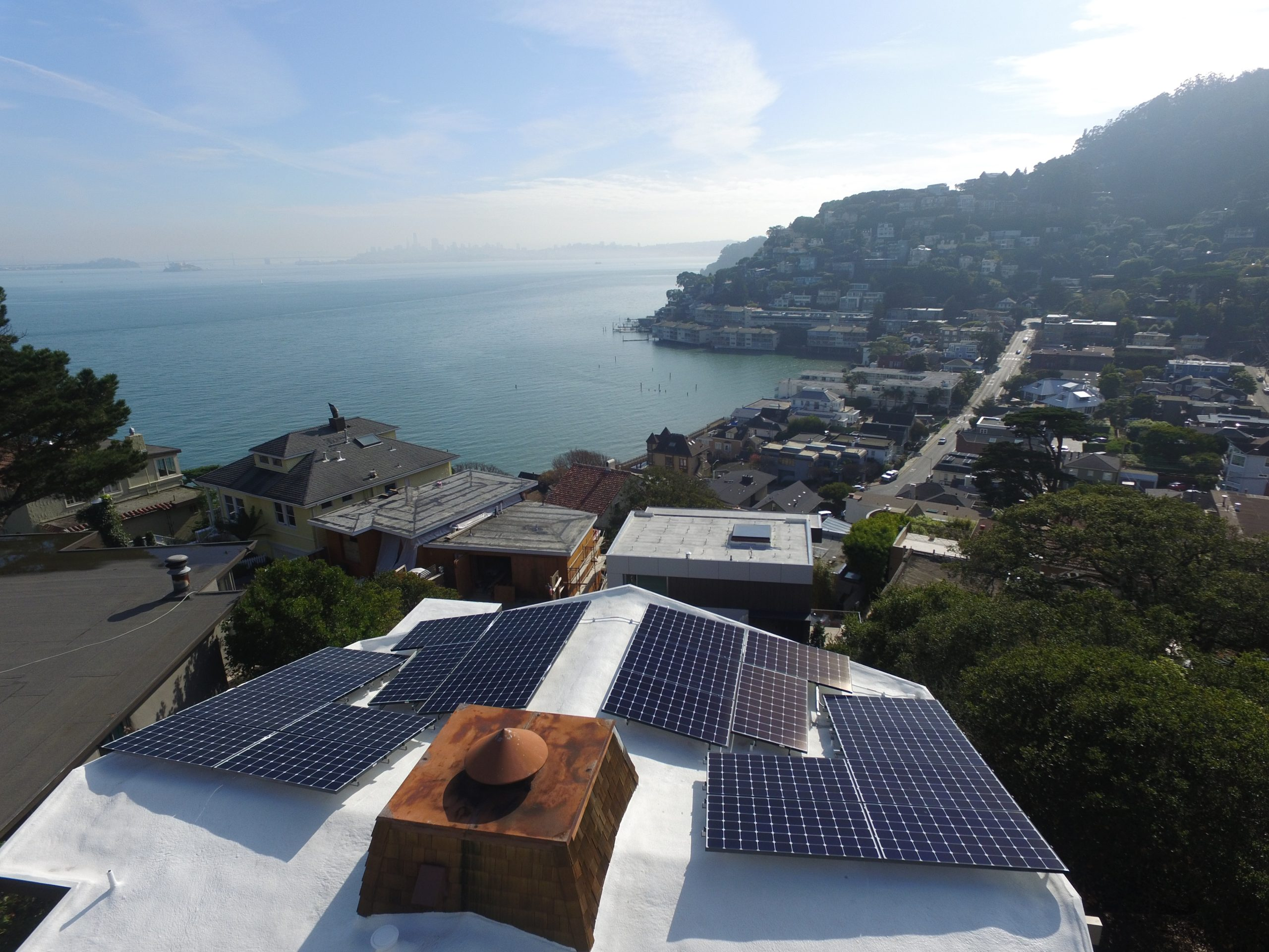 Sausalito home with rooftop solar overlooking downtown Sausalito and the water in the bay