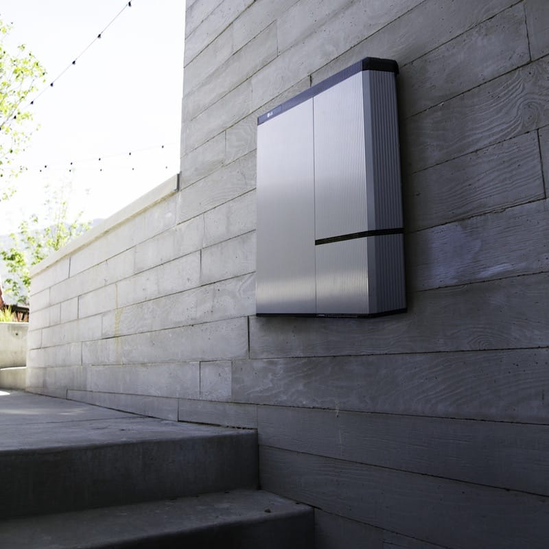 Home solar battery installed on a wooden wall above steps