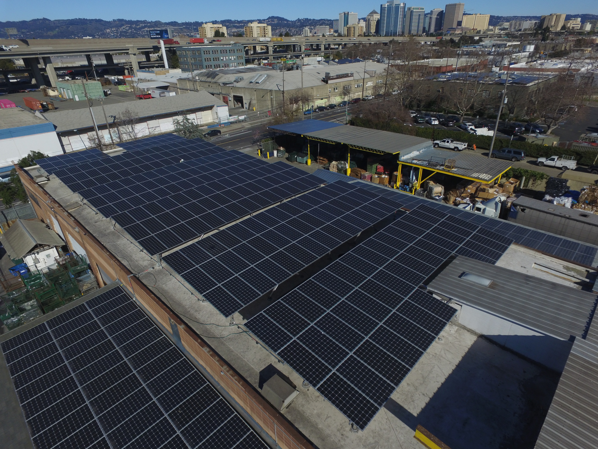 Aerial view of the commercial solar installation at Green Planet recycling center in Oakland, CA