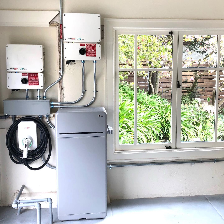 LG 16 kilowatt hour battery and SolarEdge inverter and EV charger installed inside customer's garage