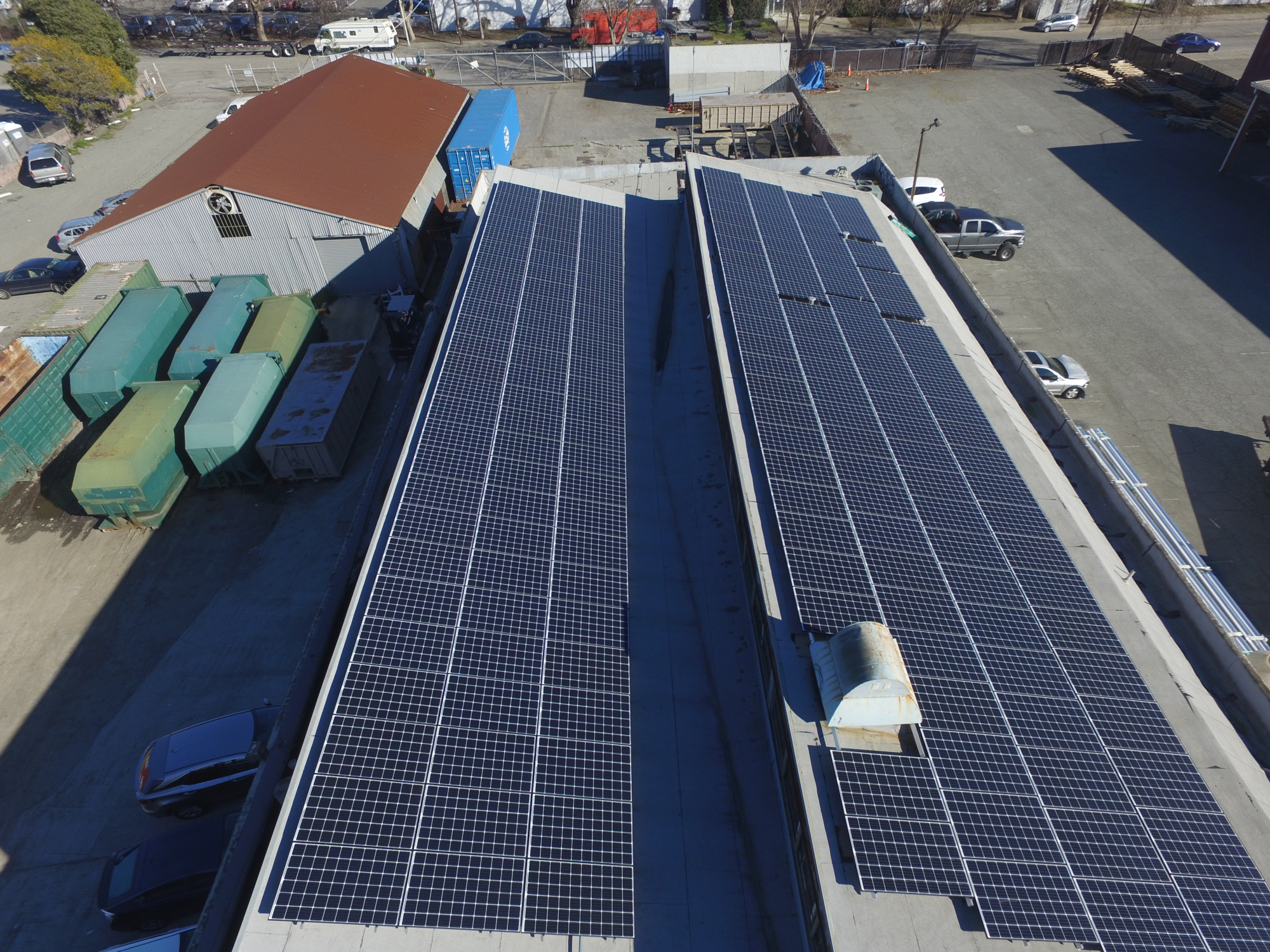 Aerial view of commercial solar installation at Green Planet offices in Oakland