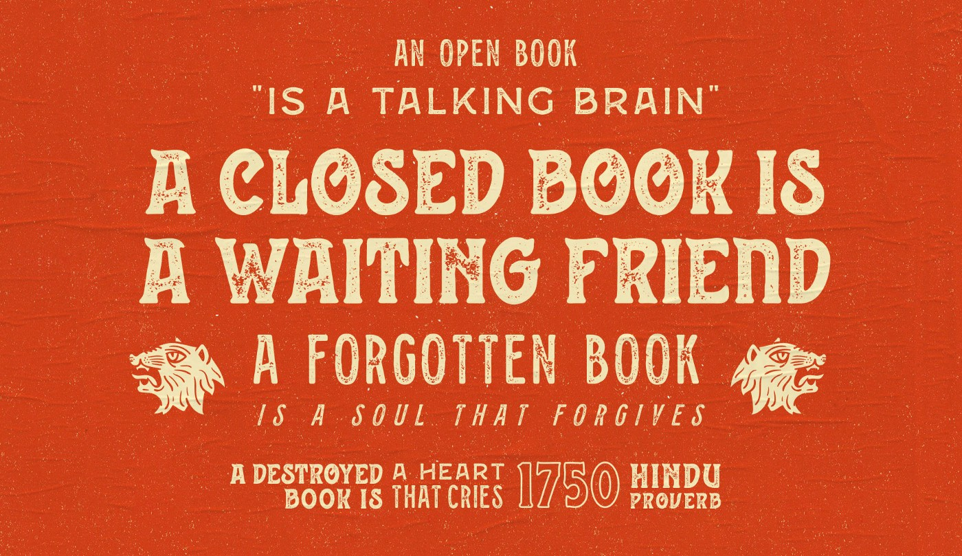 """quote in a vintage, western, slab serif font: """"an open book is a talking brain. a closed book is a waiting friend. a forgotten book is a soul that forgives."""""""