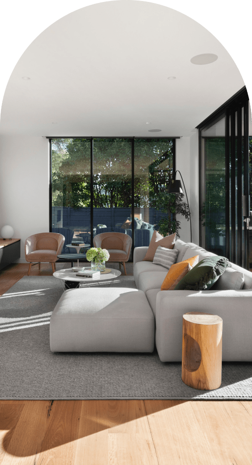 Modern livingroom with large couch and wooden table