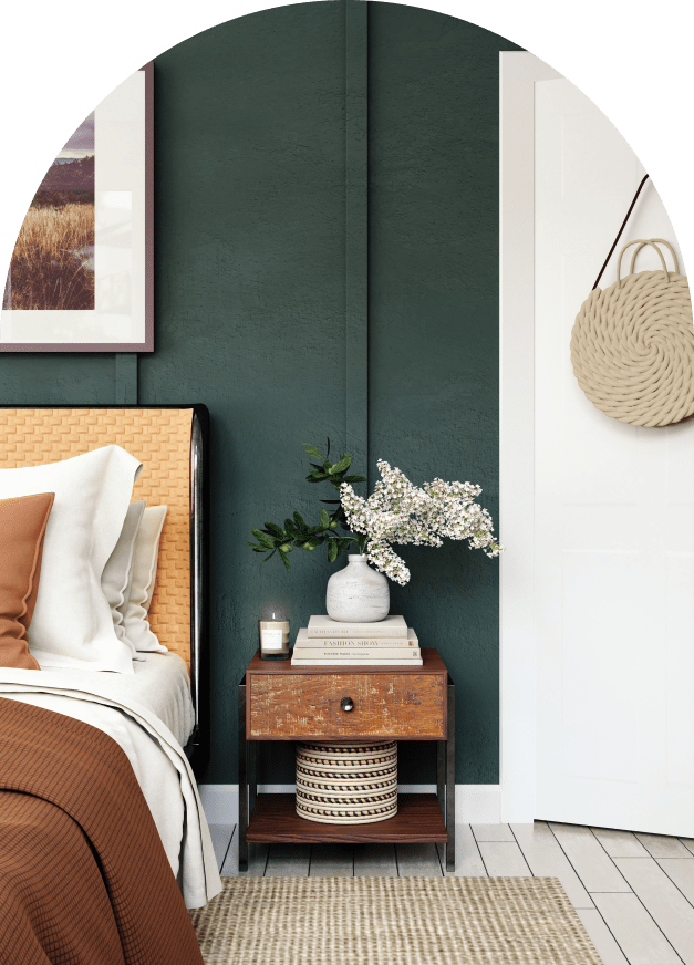 comfortable bedroom with green walls, and flowers on a nightstand
