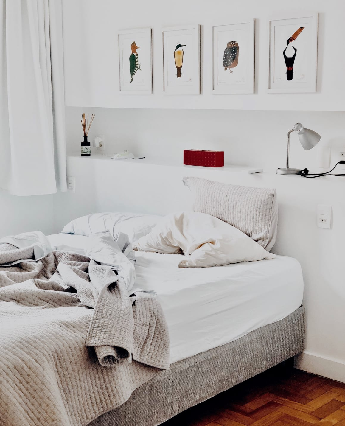 Bed with built in shelving behind
