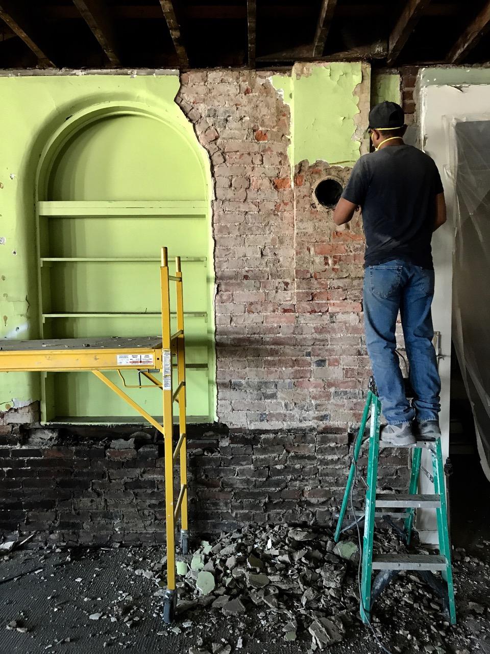 Removing concrete slurry on brick walls