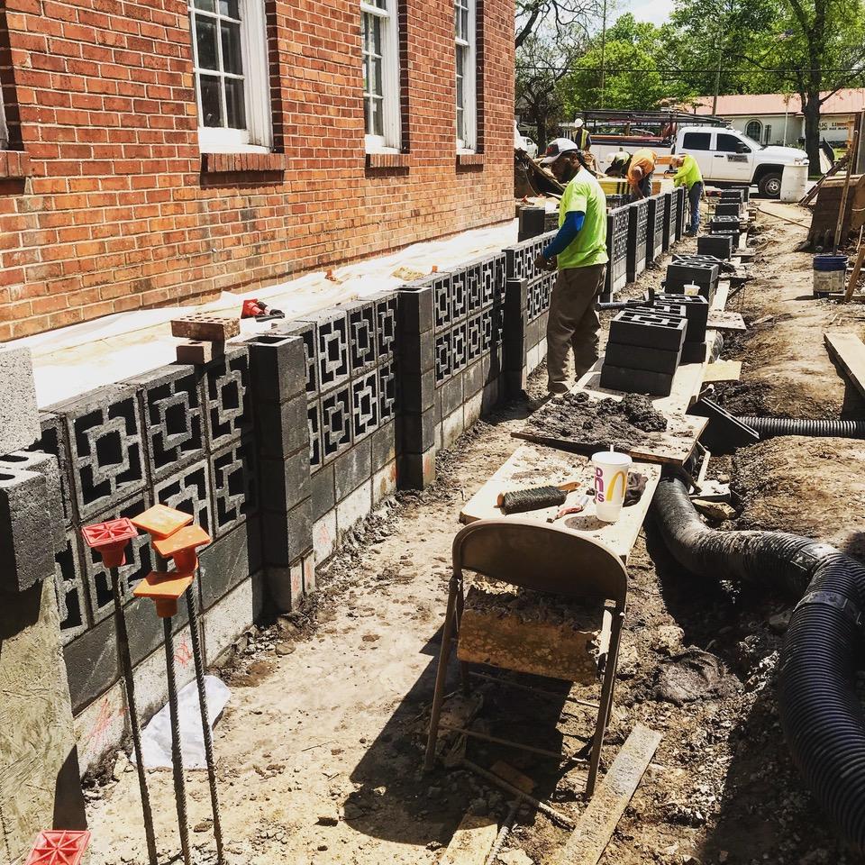 Mid-century breezeway black block wall laid