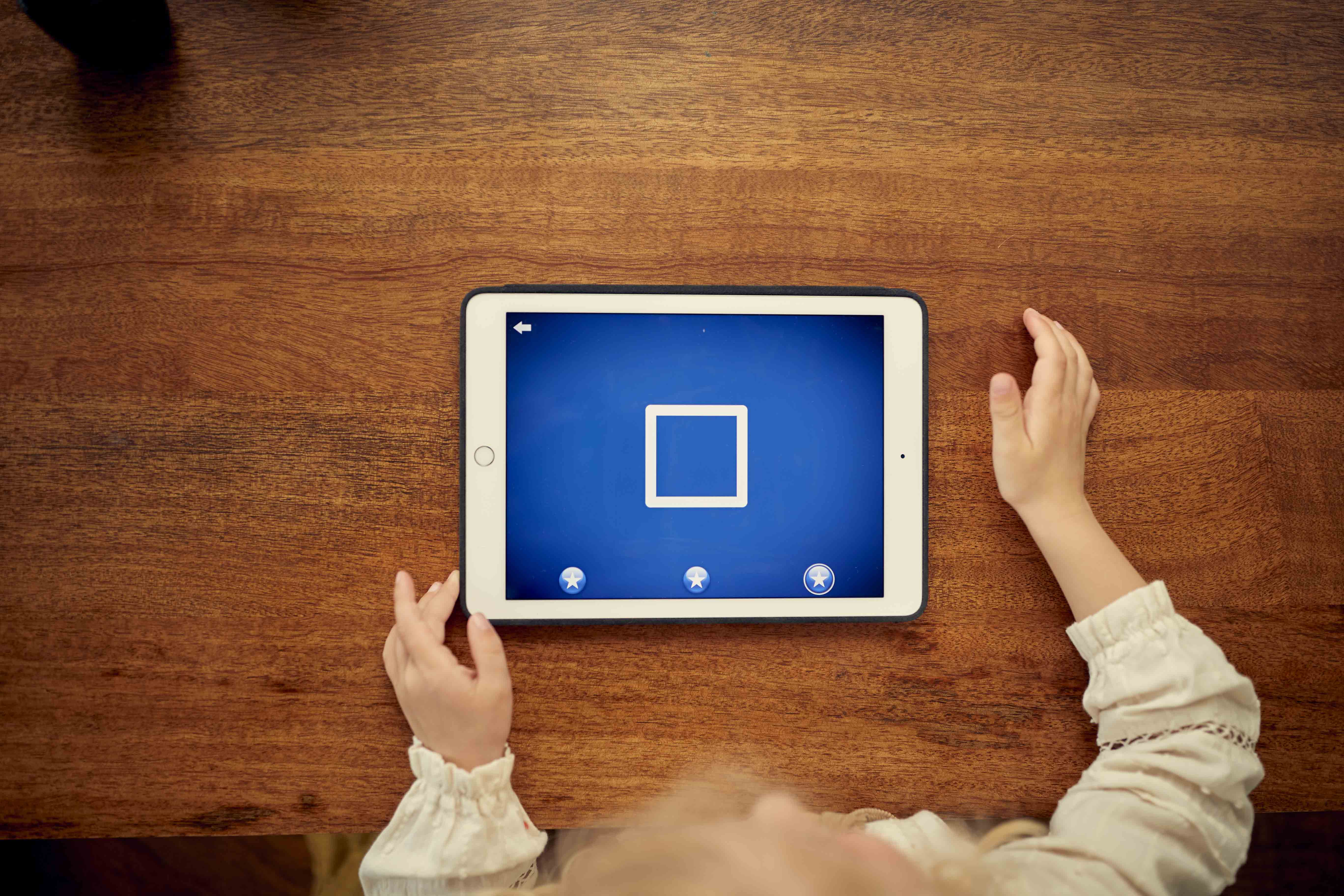 Child playing LetterSchool on the Ipad