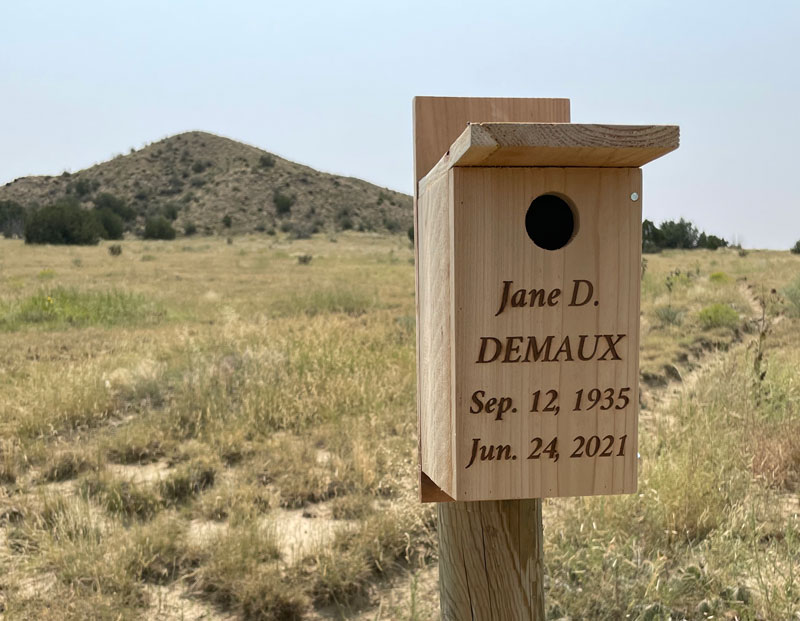 Personalized nest box memorial marker on a post