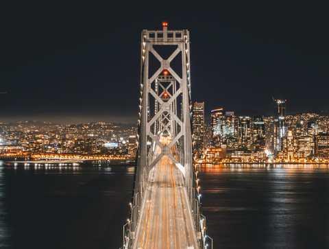 The San Francisco Bay Bridge, illuminated at night