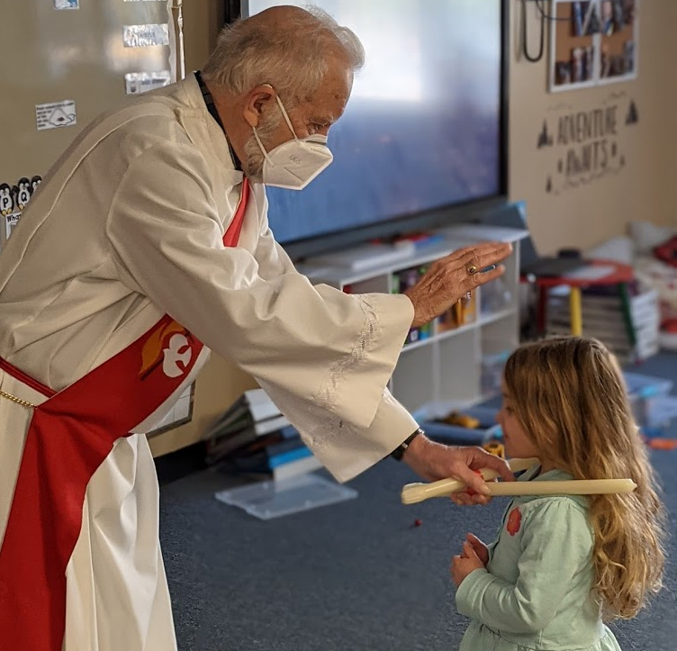 Deacon Blessing a Young Girl