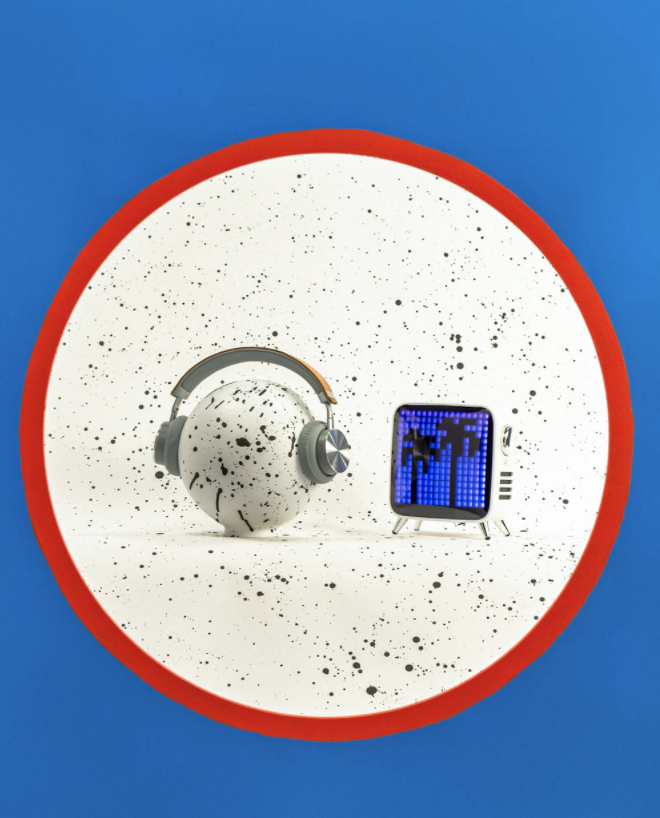 Photo of a speckled ball wearing headphones next to a digital display showing palm trees