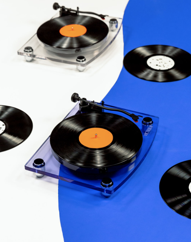 Photo of record players on a wavy, blue backdrop